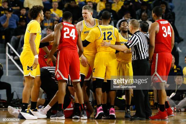 Michigan Wolverines forward Moritz Wagner has words with Ohio State Buckeyes forward Andre Wesson during the second half of a regular season Big 10...
