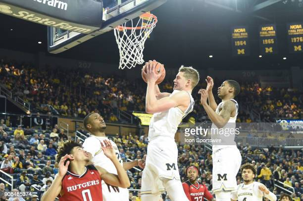 Michigan Wolverines forward Moritz Wagner hauls in a rebound during the Michigan Wolverines game versus the Rutgers Scarlet Knights on Sunday January...