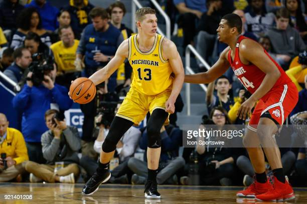 Michigan Wolverines forward Moritz Wagner looks to post up against Ohio State Buckeyes forward Kaleb Wesson during a regular season Big 10 Conference...
