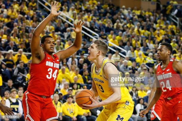 Michigan Wolverines forward Moritz Wagner looks to shoot over Ohio State Buckeyes forward Kaleb Wesson during a regular season Big 10 Conference...