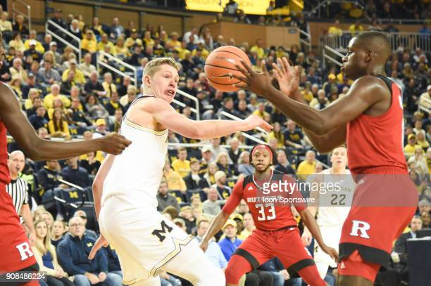 Michigan Wolverines forward Moritz Wagner loses the ball to Rutgers Scarlet Knights guard Geo Baker during the Michigan Wolverines game versus the...
