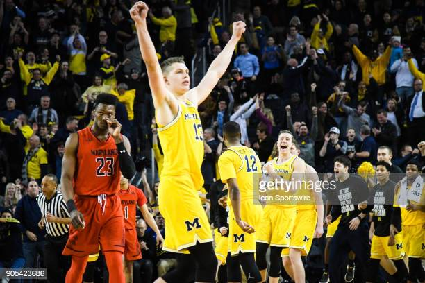 Michigan Wolverines forward Moritz Wagner Michigan Wolverines guard Duncan Robinson and the Michigan Wolverines bench erupt following the free throws...