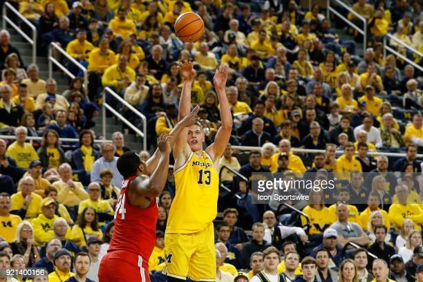 Michigan Wolverines forward Moritz Wagner shoots a jump shot over Ohio State Buckeyes forward Kaleb Wesson during a regular season Big 10 Conference...