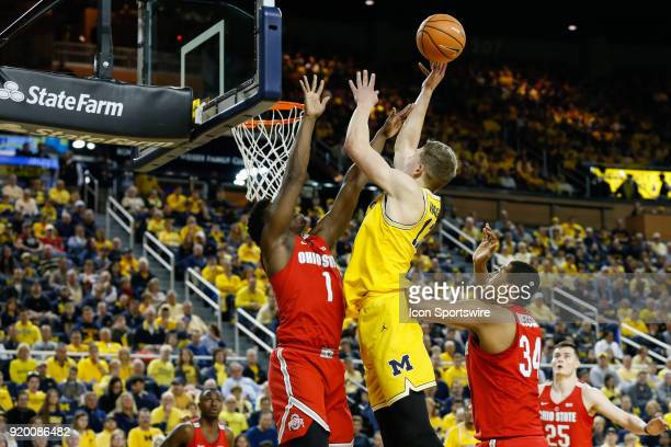Michigan Wolverines forward Moritz Wagner shoots over Ohio State Buckeyes forward Jae'Sean Tate during the first half of a regular season Big 10...