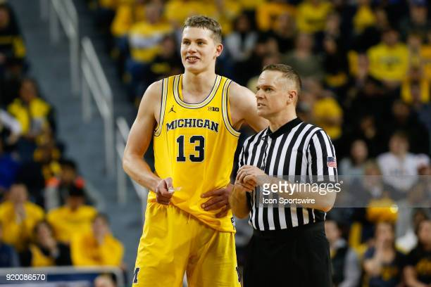 Michigan Wolverines forward Moritz Wagner talks with referee Paul Szeic during the first half of a regular season Big 10 Conference basketball game...