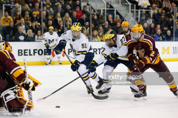 Michigan Wolverines forward Nolan Moyle and Michigan Wolverines forward Garrett Van Wyhe battle for a rebound against Minnesota Golden Gophers...