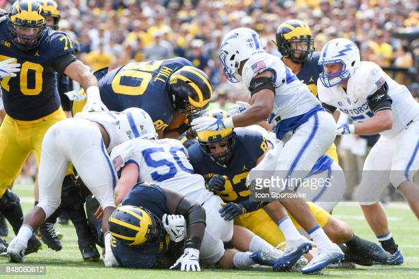 Michigan Wolverines fullback Khalid Hill dives over the pile for a first down during the Michigan Wolverines versus US Air Force Academy Falcons game...