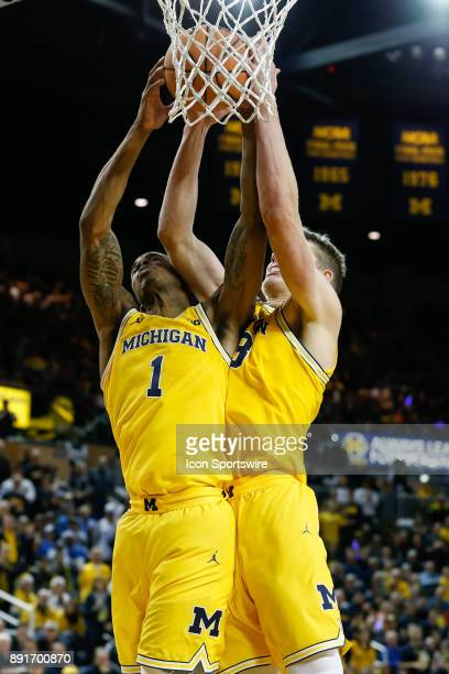 Michigan Wolverines guard Charles Matthews and Michigan Wolverines forward Moritz Wagner grab a rebound during a regular season nonconference...