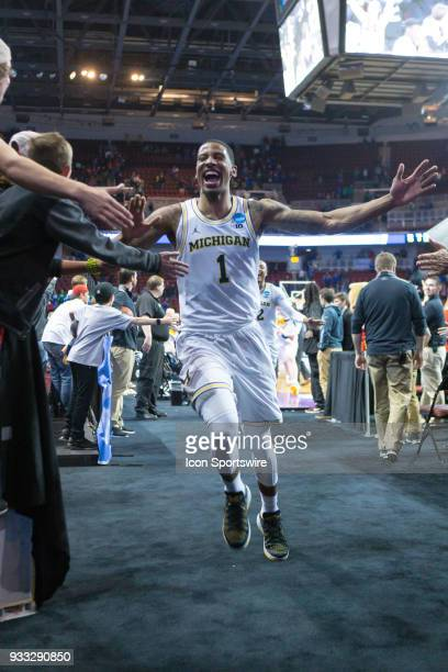 Michigan Wolverines guard Charles Matthews celebrates as he runs off court after the NCAA Tournament second round game on March 17 2018 at Intrust...