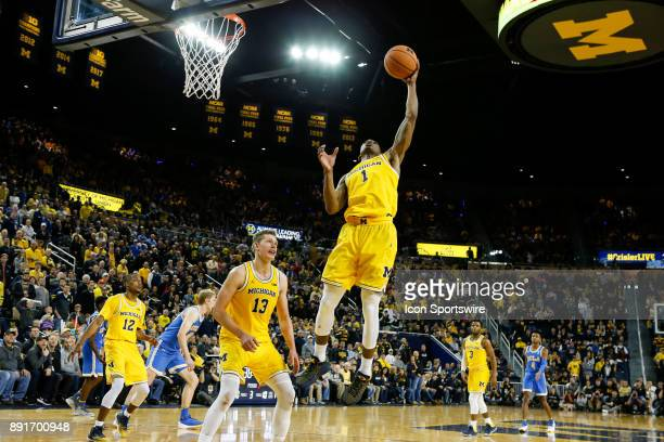 Michigan Wolverines guard Charles Matthews grabs a rebound during a regular season nonconference basketball game between the UCLA Bruins and the...
