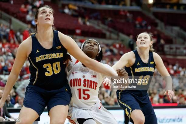 Michigan Wolverines guard Deja Church boxes out Ohio State Buckeyes guard Linnae Harper in a game between the Ohio State Buckeyes and the Michigan...