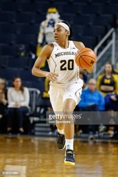 Michigan Wolverines guard Deja Church brings the ball upcourt during a regular season Big 10 Conference basketball game between the Northwestern...