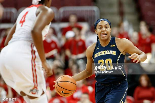 Michigan Wolverines guard Deja Church looks to pass the ball in a game between the Ohio State Buckeyes and the Michigan Wolverines on January 16 2018...