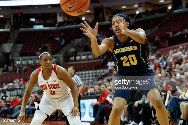 Michigan Wolverines guard Deja Church receives an inbound pass as Ohio State Buckeyes guard Kelsey Mitchell defends in a game between the Ohio State...