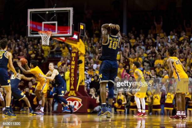 Michigan Wolverines guard Derrick Walton Jr reacts after missing a game tying 3 pointer at the end of overtime during the Big Ten Conference game...