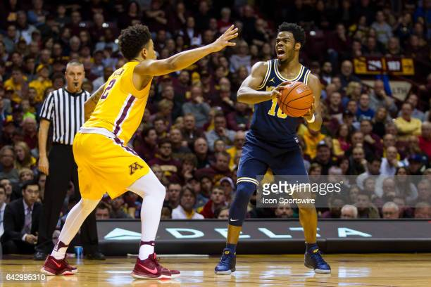 Michigan Wolverines guard Derrick Walton Jr yells while Minnesota Golden Gophers guard Nate Mason defends during the Big Ten Conference game between...