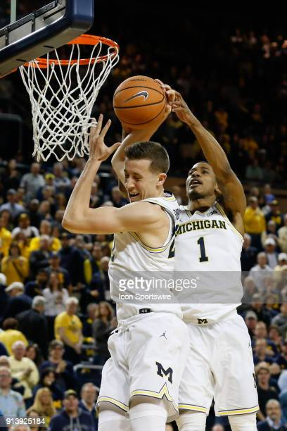 Michigan Wolverines guard Duncan Robinson and Michigan Wolverines guard Charles Matthews battle to grab a rebound during the second half of a regular...
