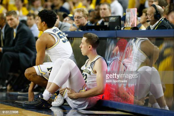 Michigan Wolverines guard Duncan Robinson and Michigan Wolverines guard Eli Brooks wait to enter the game during a regular season Big 10 Conference...