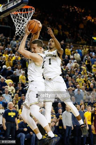 Michigan Wolverines guard Duncan Robinson and Michigan Wolverines guard Charles Matthews battle to grab a rebound during a regular season Big 10...