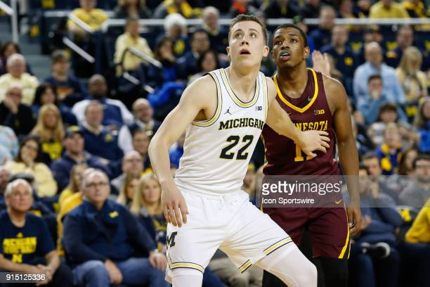 Michigan Wolverines guard Duncan Robinson boxes out Minnesota Golden Gophers guard Isaiah Washington during a regular season Big 10 Conference...