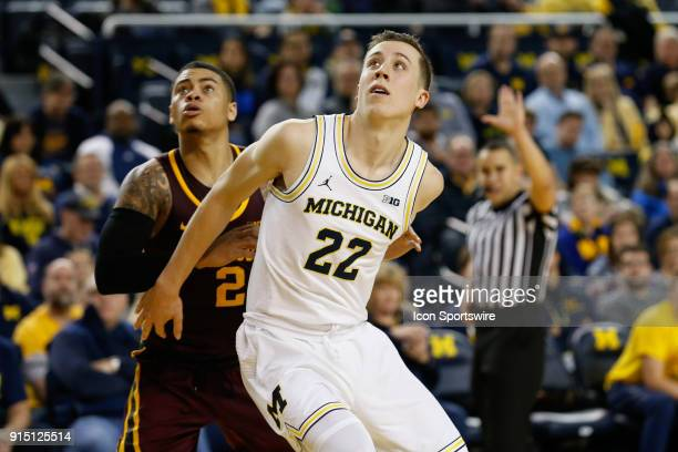 Michigan Wolverines guard Duncan Robinson boxes out Minnesota Golden Gophers guard Nate Mason during a regular season Big 10 Conference basketball...