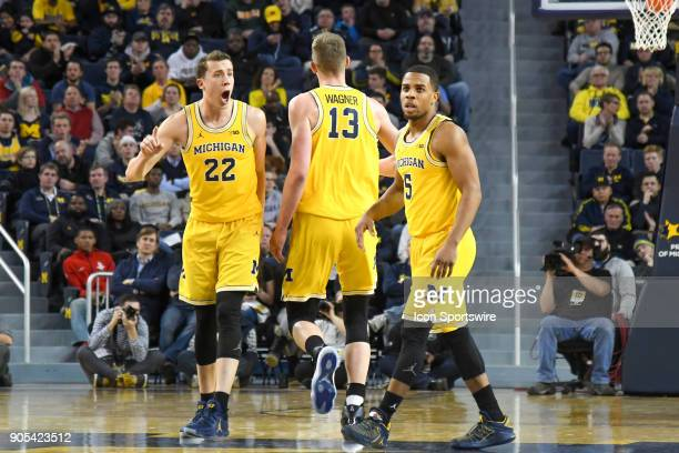 Michigan Wolverines guard Duncan Robinson cheers Michigan Wolverines forward Moritz Wagner after he hit a three point shot during the Michigan...
