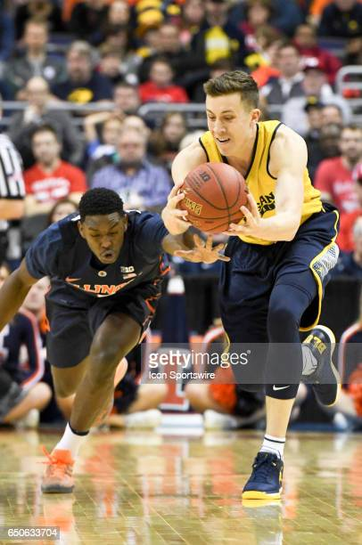 Michigan Wolverines guard Duncan Robinson dives for a loose ball against Illinois Fighting Illini guard Te'Jon Lucas in the second round of the Big...