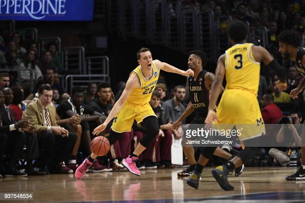 Michigan Wolverines guard Duncan Robinson drives to the basket against Florida State Seminoles guard Terance Mann in the fourth round of the 2018...