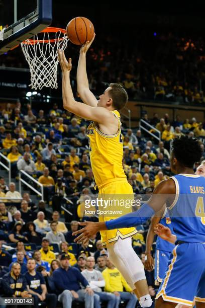 Michigan Wolverines guard Duncan Robinson goes in for a layup during a regular season non-conference basketball game between the UCLA Bruins and the...