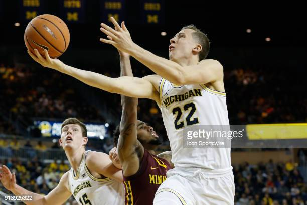 Michigan Wolverines guard Duncan Robinson goes in for a layup during the first half of a regular season Big 10 Conference basketball game between the...
