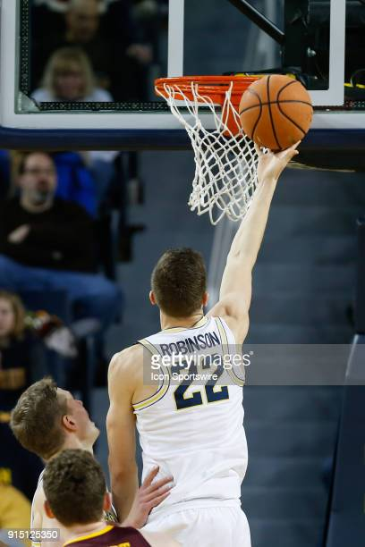 Michigan Wolverines guard Duncan Robinson goes in for a layup during a regular season Big 10 Conference basketball game between the Minnesota Golden...