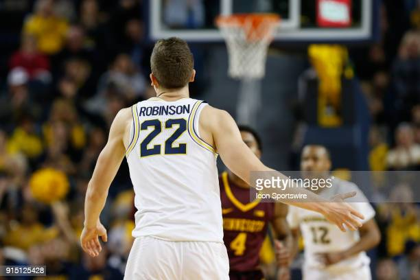 Michigan Wolverines guard Duncan Robinson looks on during a regular season Big 10 Conference basketball game between the Minnesota Golden Gophers and...