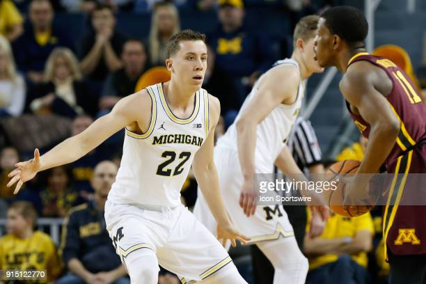 Michigan Wolverines guard Duncan Robinson plays defense during a regular season Big 10 Conference basketball game between the Minnesota Golden...