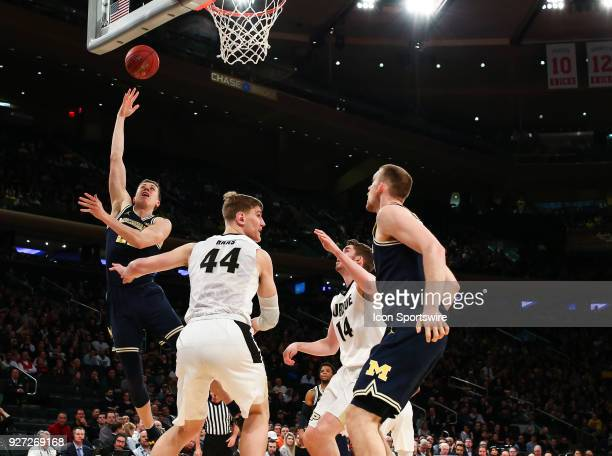 Michigan Wolverines guard Duncan Robinson puts up a hook shot during the Mens College Basketball Big Ten Tournament Championship Game betweenthe...