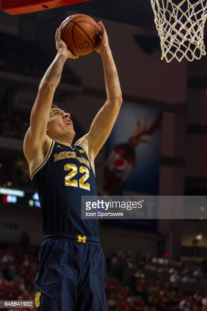 Michigan Wolverines guard Duncan Robinson puts up a layup against the Nebraska Cornhuskers during the second half on Match 05 at the Pinnacle Bank...