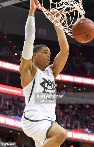 Michigan Wolverines guard Duncan Robinson scores on a dunk against the Penn State Nittany Lions in the second round of the Big 10 Tournament game...