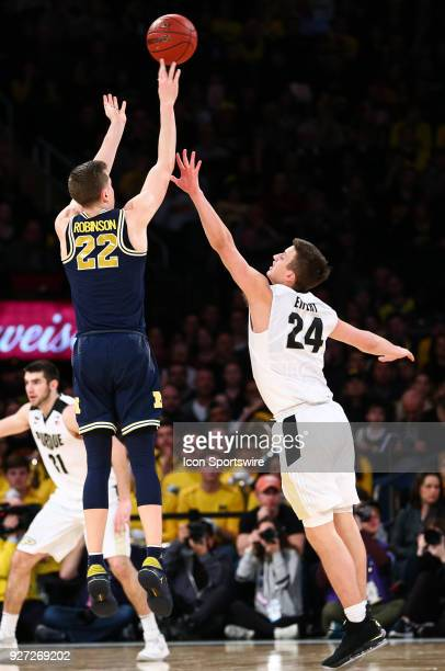 Michigan Wolverines guard Duncan Robinson takes a 3point shot during the Mens College Basketball Big Ten Tournament Championship Game betweenthe...