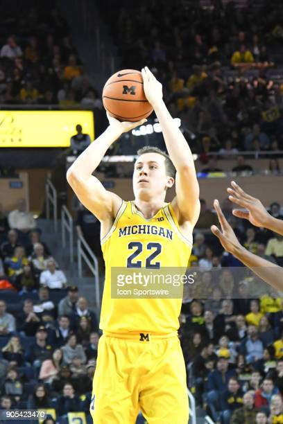 Michigan Wolverines guard Duncan Robinson takes a three point shot during the Michigan Wolverines game versus the Maryland Terrapins on Monday...