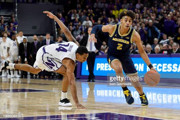 Michigan Wolverines guard Jordan Poole dribbles past Northwestern Wildcats guard Ryan Taylor on December 4 2018 at the WelshRyan Arena in Evanston...