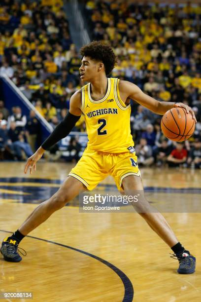 052a3a43b1d Michigan Wolverines guard Jordan Poole dribbles the ball during the first  half of a regular season