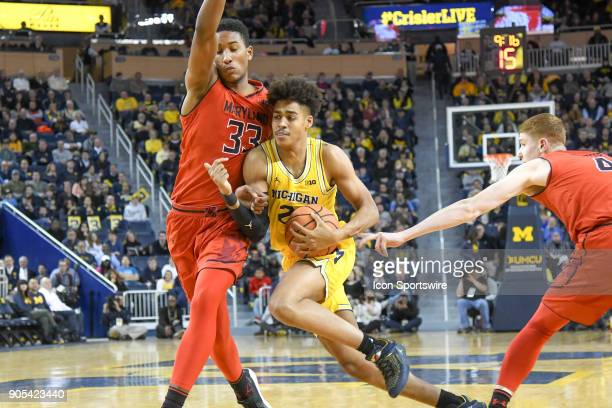 Michigan Wolverines guard Jordan Poole drives to the lane and is fouled by Maryland Terrapins forward Joshua Tomaic during the Michigan Wolverines...