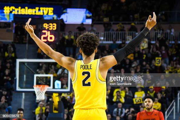 Michigan Wolverines guard Jordan Poole employees the crowd to cheer after another three point basket during the Michigan Wolverines game versus the...