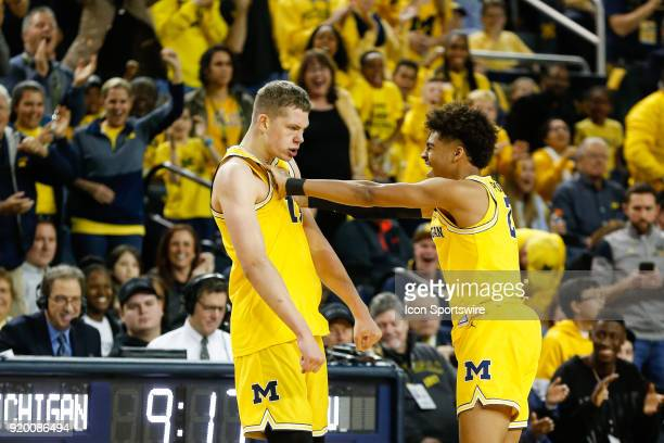 Michigan Wolverines guard Jordan Poole gives Michigan Wolverines forward Moritz Wagner celebratory shove after a defensive play during the first half...