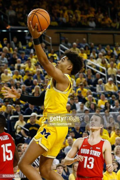 Michigan Wolverines guard Jordan Poole goes in for a layup during the first half of a regular season Big 10 Conference basketball game between the...