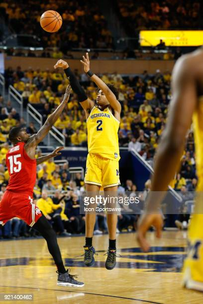 Michigan Wolverines guard Jordan Poole shoots a jump shot over Ohio State Buckeyes guard Kam Williams during a regular season Big 10 Conference...