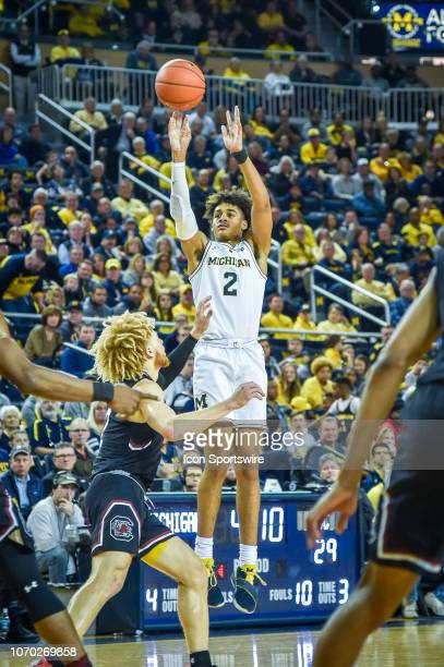 Michigan Wolverines guard Jordan Poole shoots a three point shot and is fouled during the Michigan Wolverines game versus the South Carolina...