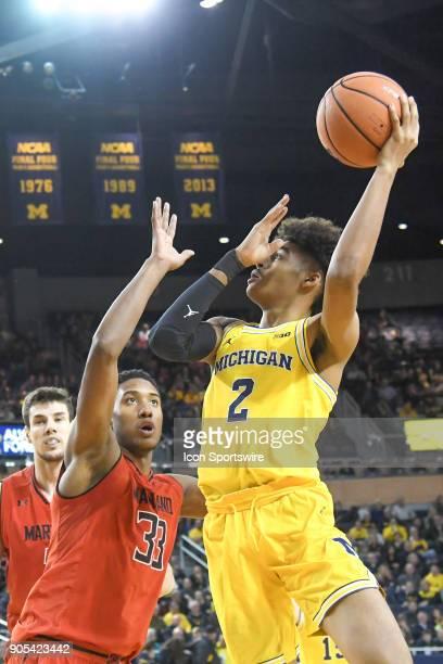 Michigan Wolverines guard Jordan Poole takes a short jumper over Maryland Terrapins forward Joshua Tomaic during the Michigan Wolverines game versus...