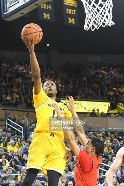 Michigan Wolverines guard MuhammadAli AbdurRahkman goes in for a layup during the Michigan Wolverines game versus the Maryland Terrapins on Monday...