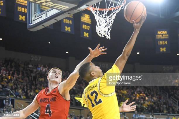 Michigan Wolverines guard MuhammadAli AbdurRahkman takes a reverse layup with Maryland Terrapins guard Kevin Huerter defending him during the...
