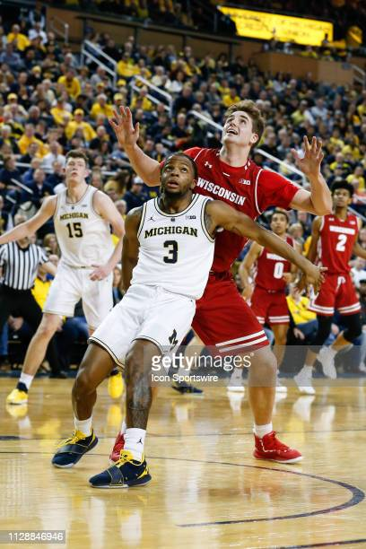 Michigan Wolverines guard Zavier Simpson boxes out Wisconsin Badgers forward Nate Reuvers under the basket during a regular season Big 10 Conference...